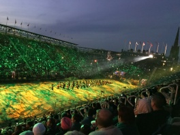 The field in front of Edinburgh Castle is lit up with many different lighting effects for the Tatoo.