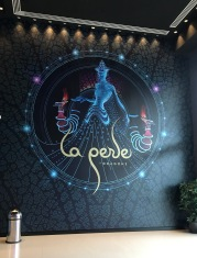 La Perle logo in the ornate lobby of the dedicated theater.