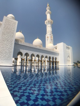 Beautiful blue pools of water are found throughout the Sheikh Zayed Grand Mosque complex.