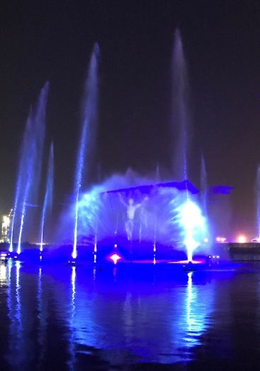 You can see the hologram image of a dancer in the center of the water plumes.