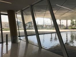 The Etihad Museum appears to float on water surrounding portions of the structure.