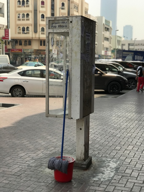 There are still phone booths in Satwa, an old part of Dubai. Great place to rest a mop, I suppose...