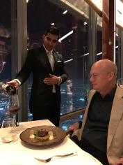 Jimmy enjoys an excellent wine at At.mosphere, Burj Khalifa.