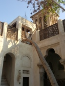 Historic Arabic architecture in Dubai's Bastakiya district. The windtowers were an early mode of air conditioning, puling breezes through the house.