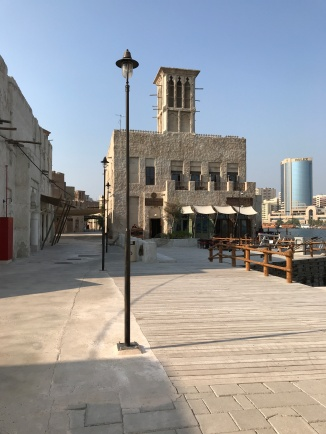 """The main drag of the new Al Seef """"history"""" section. Note that the walkways are wider than in the true historic district - making room for crowds, no doubt. Also the buildings are built right on the water."""