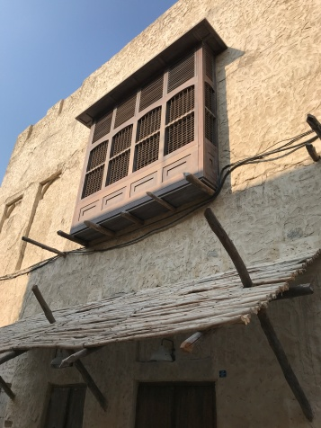 A newly constructed element of old - the mashrabiya, a patio designed to allow occupants to look on the street and enjoy cool breezes while those passing by could not look in.