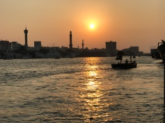 Sunset over Dubai Creek where a one dirham (27 cents) dhow ride will get you across to the souks on the other side of the creek.