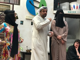 Explaining traditional dress at Dubai's wonderful Center for Cultural Understanding.