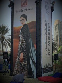 Kiosk advertising Dubai's Modest Fashion Show in Burj Park.