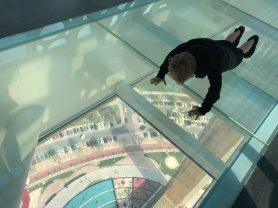 Tourist does pushups at the top of the world... er, the Dubai Frame.