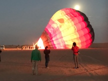 The hot air balloon getting filled in the desert outside Dubai.