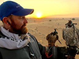 The falconer and his charges above the Empty Quarter outside Dubai.