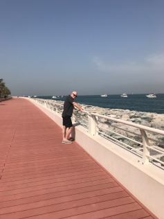 Husband Jimmy enjoying the view along the seawall (tons of yachts, the skyline, and of course Burj Al Arab are all visible from the east crescent)..