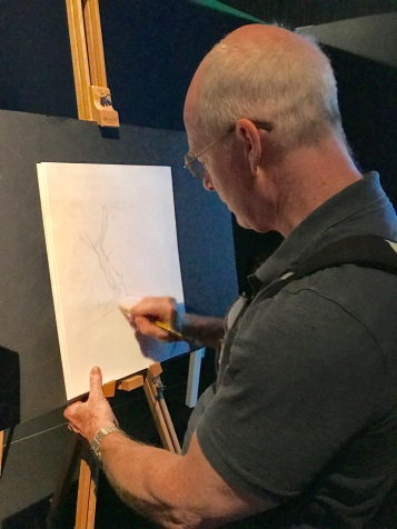 My husband Jimmy sketches in the portion of the exhibit that invites visitors to try their hand at sketching (Jimmy does lots of sketching always... why not here?)