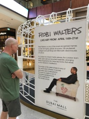My husband JImmy takes at look at the temporary studio for Robi Walters in the Dubai Mall.
