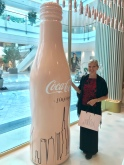 Dubai and Atlanta and me with a huge pink Coca Cola bottle, half a world away from Coke headquarters...