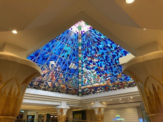The Wafi Mall in Bur Dubai features a stained glass pyramid with various scenes.