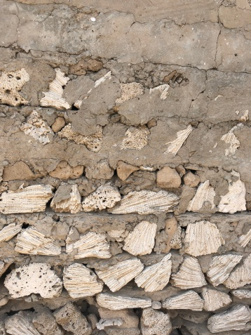 The crumbling walls reveal the coral used in the construction of walls at Al Jazirat Al Hamra.