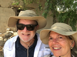 Jimmy and I seeking shelter during a 101 degree day visit to Al Jazirat Al Hamra.