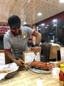 Our server prepares the largest lobster I have ever seen at Al Shamaliah restaurant in Khasab, Oman