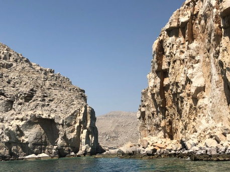 A view of the Oman Musandam fjords - large towering cliffs formed by early volcanic activity.