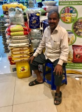 """The cool character of the old market is gone, but you can still find """"cool characters"""" at Dubai's Waterfront Market, like this friendly storekeeper in the dry goods section."""