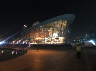 "The Dubai Opera House at night - it is shaped like a large ""dhow"" or sailing vessle."