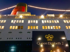 The QE2 at dusk, docked in Dubai, UAE.