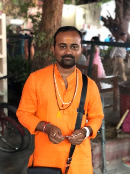 An astrologer outside the Hindu Temple.
