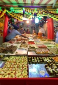 One of the many bakeries offering many different types of Indian sweets.